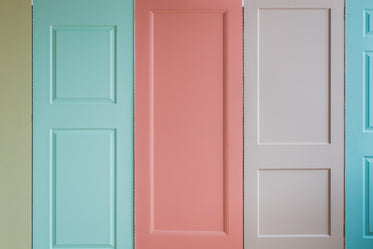 a wall of pastel colored doors