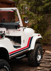 a white convertible jeep with a red and blue stripe