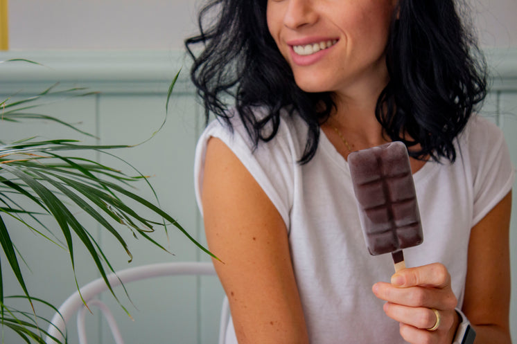 a-woman-with-dark-hair-smiles-holding-an-ice-cream.jpg?width=746&format=pjpg&exif=0&iptc=0