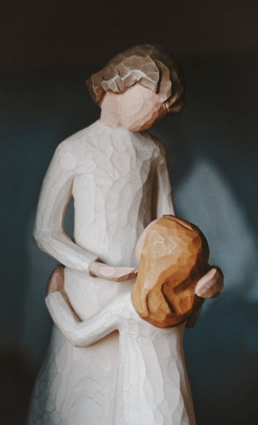 a wooden figurine of mother and child