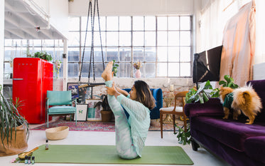 a yoga instructor preforms a difficult position