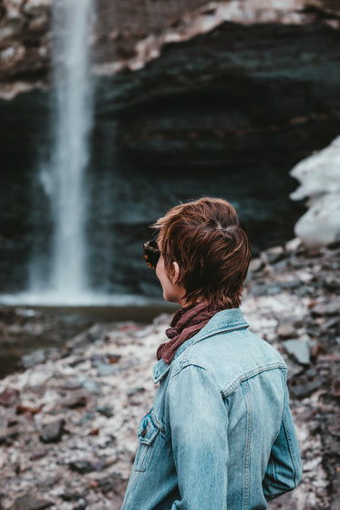 a young woman gazes across the scenery