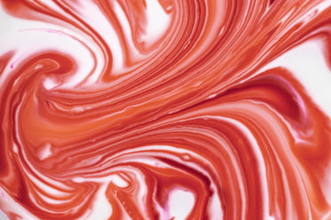 abstract photo of red marbling into white