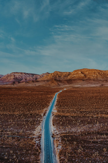 aerial photo of paved road through the desert