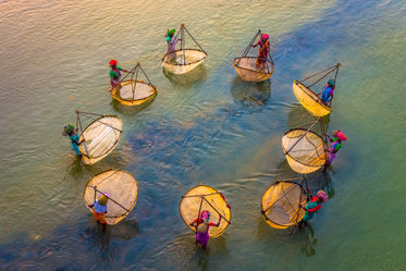 aerial photo of people stands in a circle in water