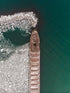 aerial view of a ship surrounded by ice
