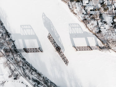 aerial view of a swing bridge frozen in time