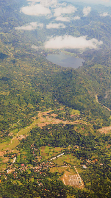 aerial view of lake surrounded by mountains