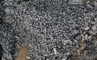 aerial view of mountains of crushed metal cubes