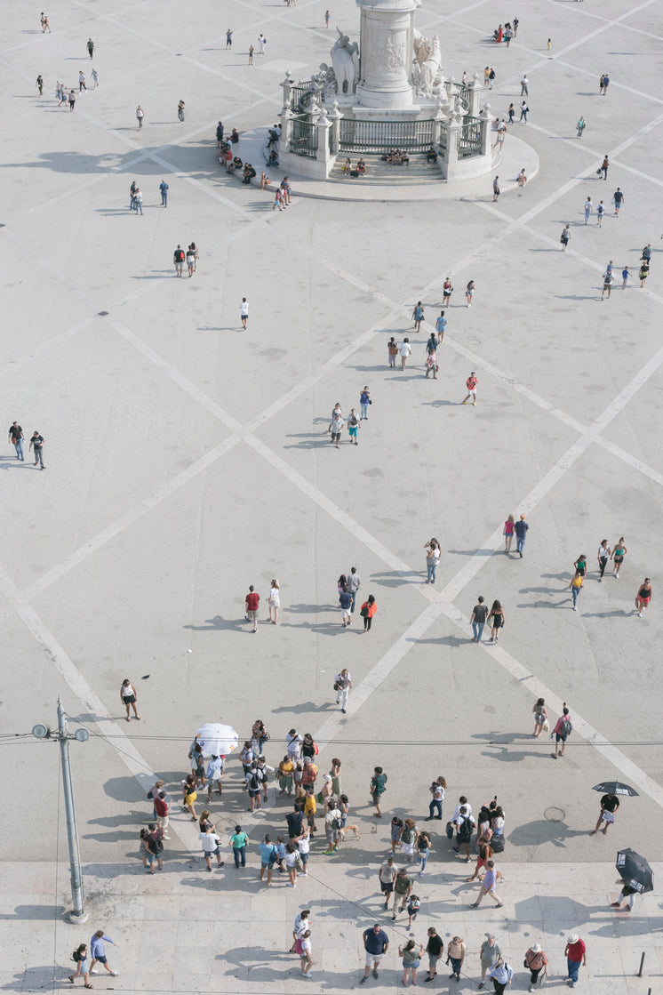 Aerial View Of People At The Rua Augusta Arch