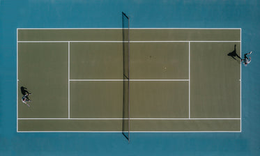 aerial view of two people playing tennis in the sun