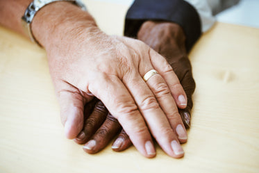 aged couple hands