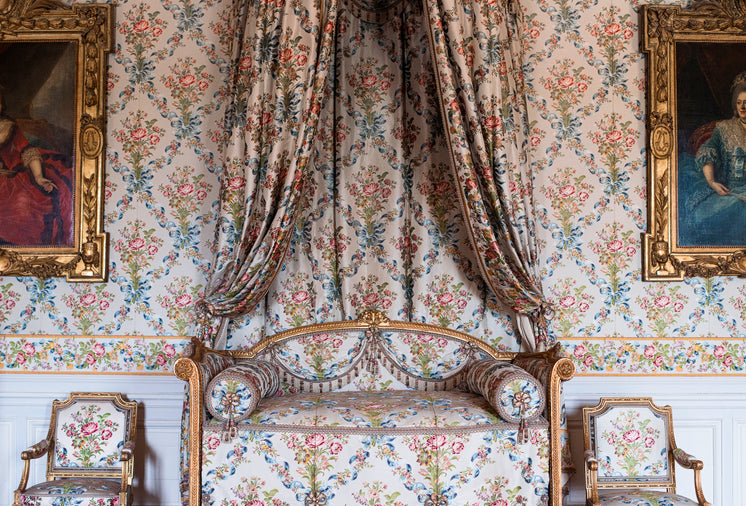 An Antique Couch With Matching Curtains