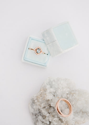 an engagment ring sits in a blue box