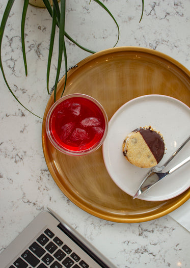 an ice-cream sandwich and a glass of red juice