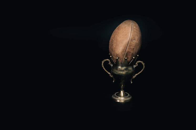 an-old-leather-football-and-trophy.jpg?w
