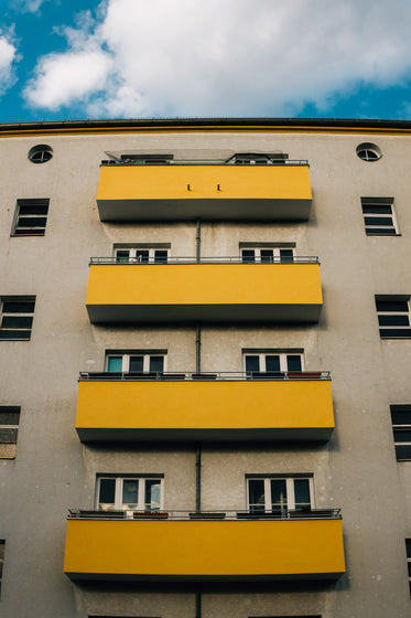 apartment building with yellow balconies