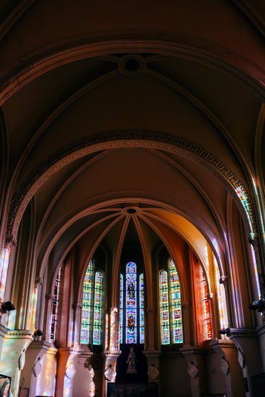 arched interior of a building with stained glass