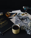 artsy layout with a book and coffee