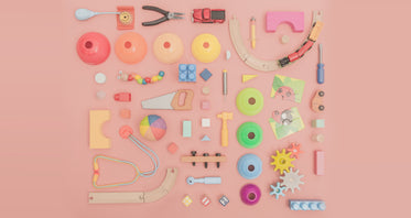 assortment of toys on pink