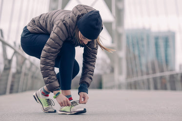 athlete tying running shoes