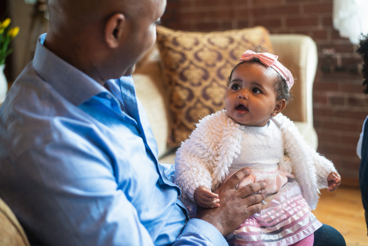 Baby Looks At Father