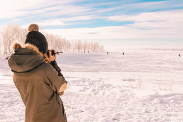back of person taking a photo of a winter day