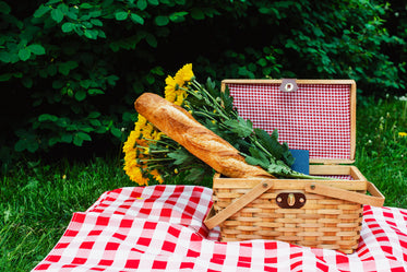 baguette and flowers in picnic basket