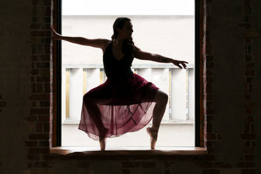 ballet dancer on pointe in window