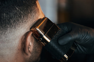 barber shaves side of persons head
