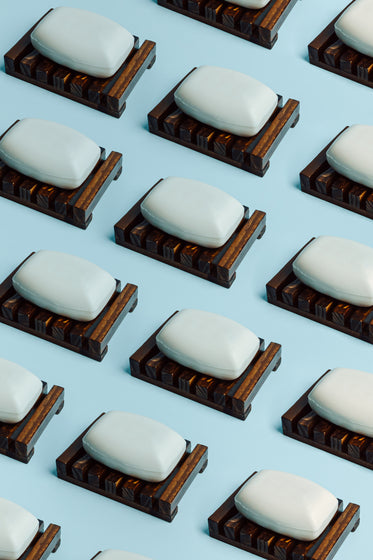 bars of soap lay on a wooden surface