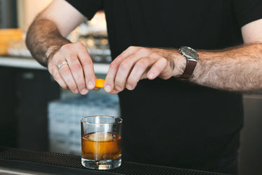 Browse Free HD Images of Bartender Adding Twist To Drink