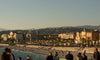 beach and overlooking city with people exploring