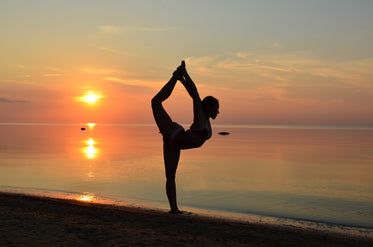 beach yoga pose- in sand at sunset