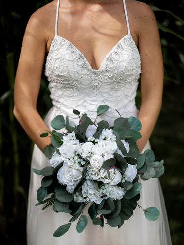 beaded wedding dress with white bouquet