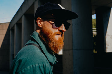 bearded man in sun and shadow