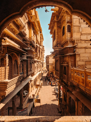 beautiful city street with stone building and carved balconies