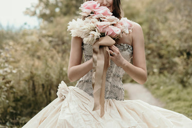 beautiful flowers in brides hands