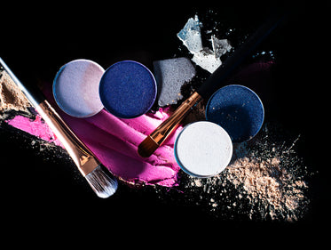 beauty products and makeup on black background