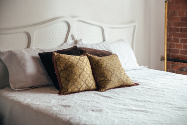 bedroom bed with brown throw pillows