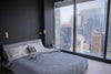 bedroom with a black wall and large windows