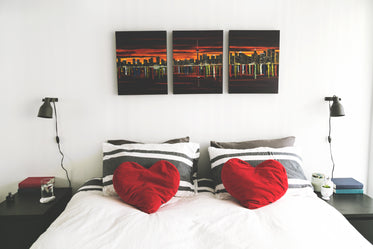 bedroom with heart pillows