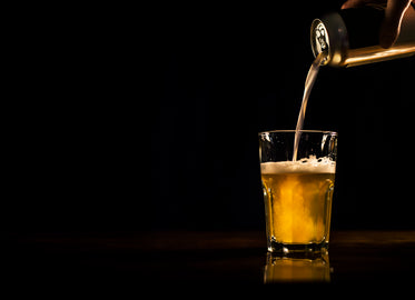 beer pouring from can to glass