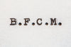bfcm typed on white paper