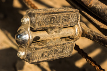 bicycle pedal covered in dirt