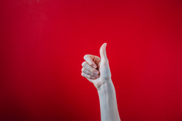 big thumbs up on red background