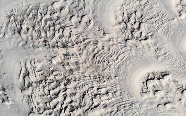 bird's-eye view of winter landscape carved by wind