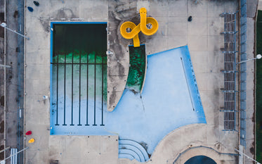 birds eye view of closed pool with waterslide