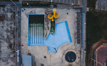 birds eye view of empty pool with waterslide
