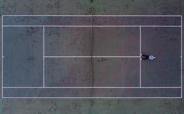 birds eye view of tennis courts with man